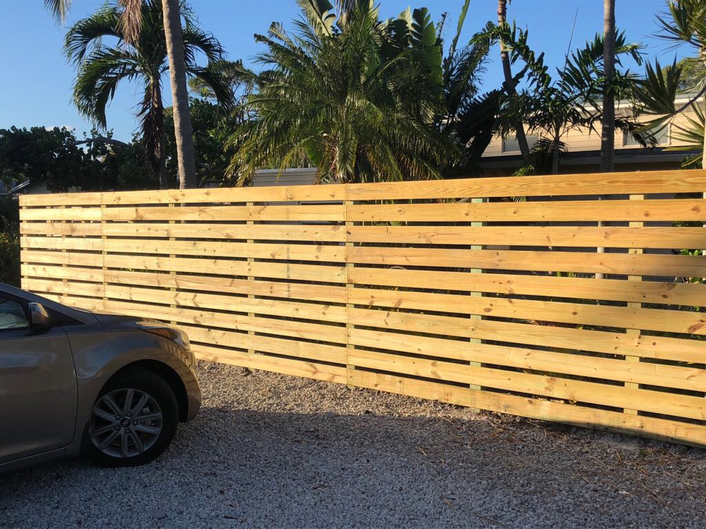 wood fence installation plantation fl